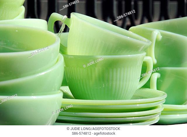 1950's Vintage Green Glass Dishes displayed at an outdoor flea market