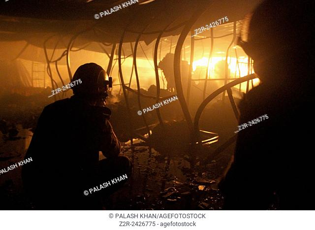 Firefighters try to control a fire inside a garment factory in the Bangladeshi town of Gazipur, 40 km (25 miles) north of the capital Dhaka October 9, 2013