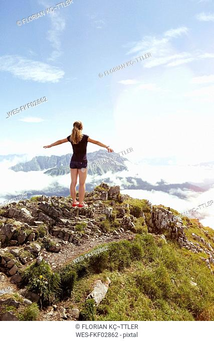 Austria, South Tyrol, female hiker, teenage girl arms outstretched