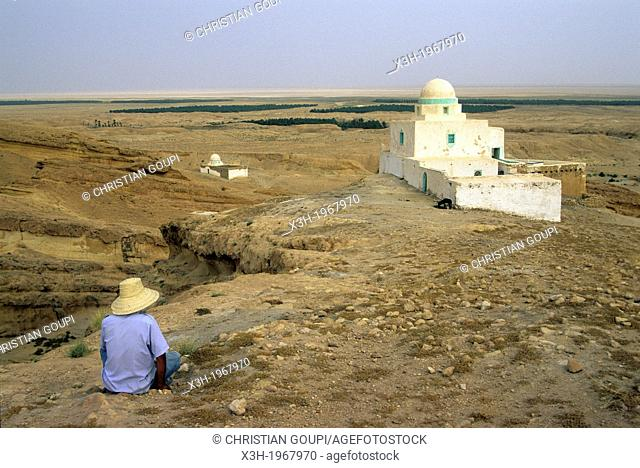 man sitting near a marabout around Tunis, Tunisia, North Africa