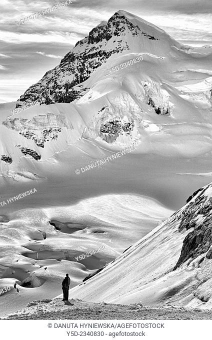Young couple admiring view from Jungfraujoch, Swiss Alps, Switzerland