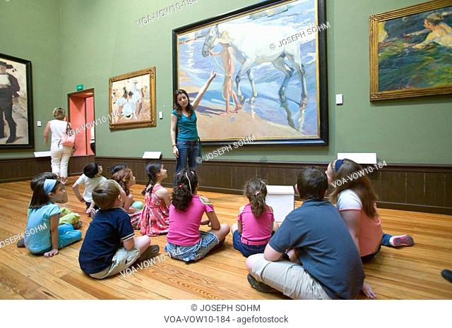 Children have lesson on paintings by Joaquín Sorolla y Bastida 1863-1923 as seen in The Sorolla Museum, Madrid, Spain