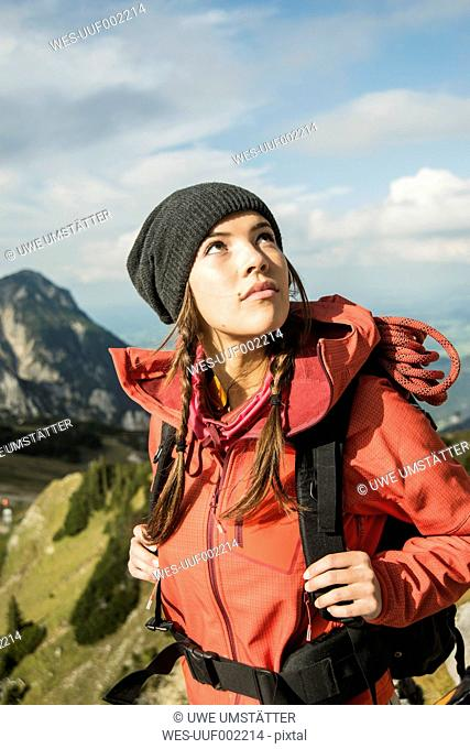 Austria, Tyrol, Tannheimer Tal, young woman looking up