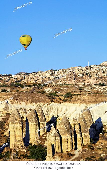 Turkey - Cappadocia - hot air balloon over rock formations at Gorome