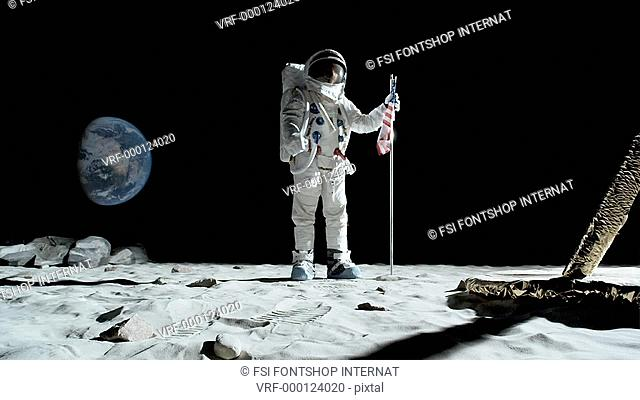 SLO MO, WS, Lockdown, astronaut putting up an American flag on the moon