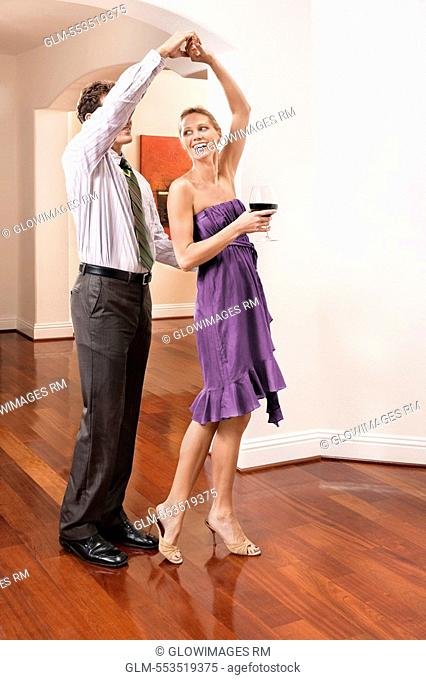 Couple celebrating in a house
