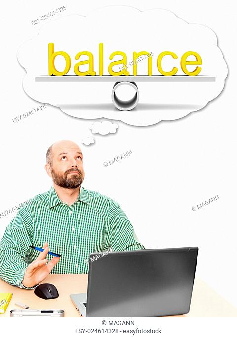 An image of a handsome business man thinking about work life balance