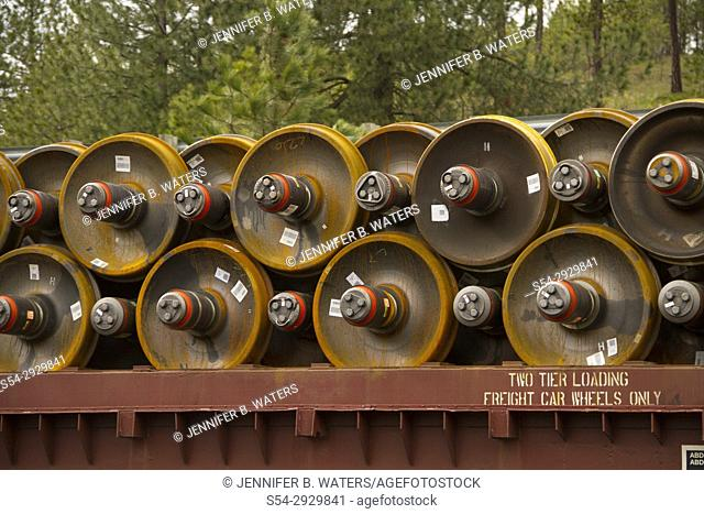 Train wheels being transported on a train car in Marshall, Washington, USA