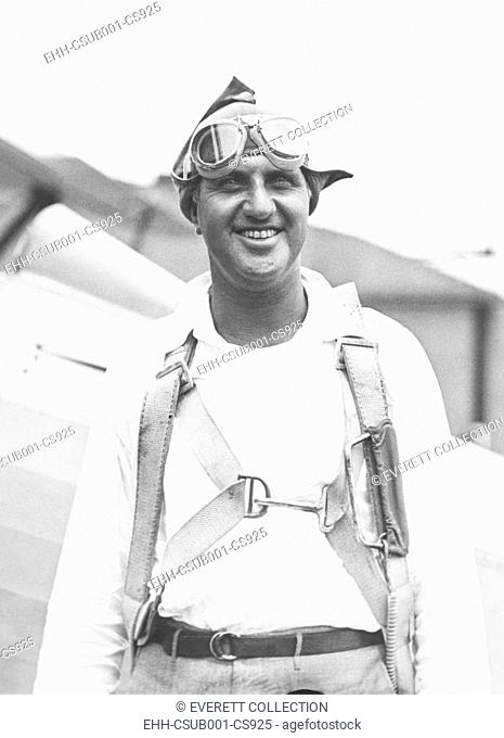 Harry F. Guggenheim arriving at Mitchell Field, Long Island, after 12 1/2 hour flight from Havana. July 1930. He headed the Daniel Guggenheim Fund for the...