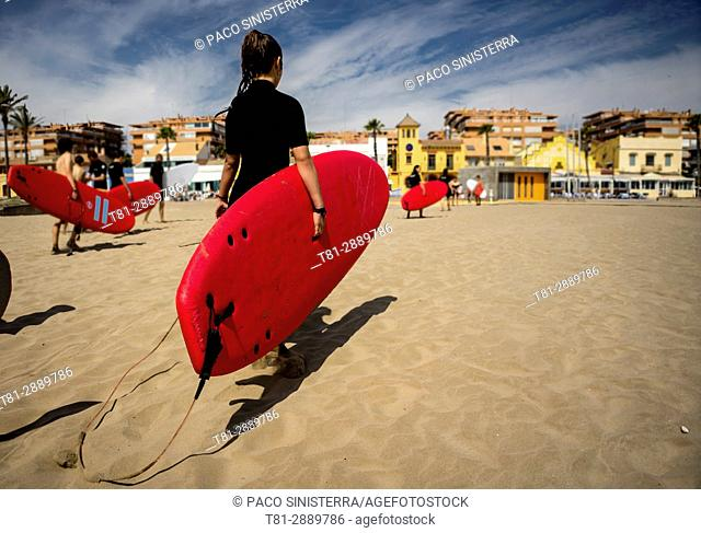 Girl with surfboard, Valencia, Spain