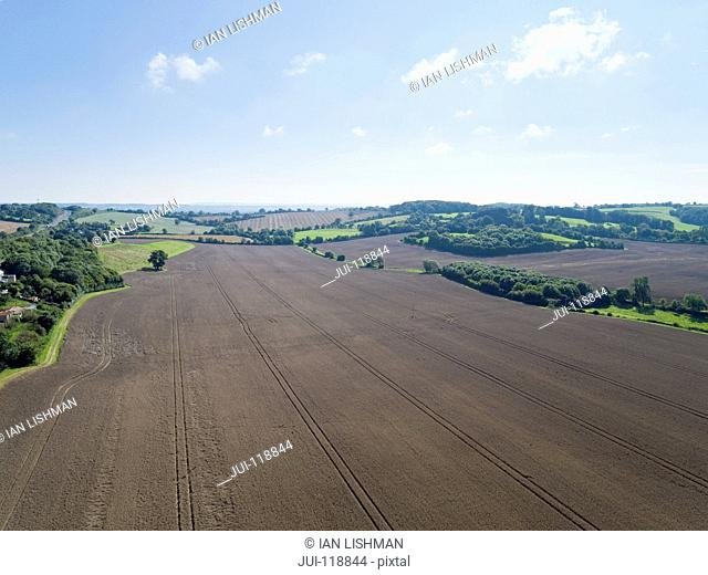 Aerial view of summer country farming landscape and wheat field ready for harvest
