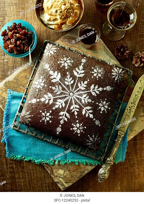 Gingerbread Christmas cake with icing sugar snowflake pattern