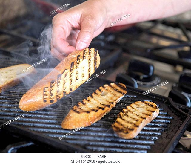 Bread being grilled