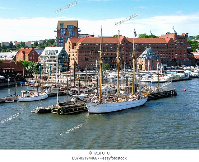 Jetties with sailboats and yachts along Gota Alv River in the harbour of Gothenburg, Sweden
