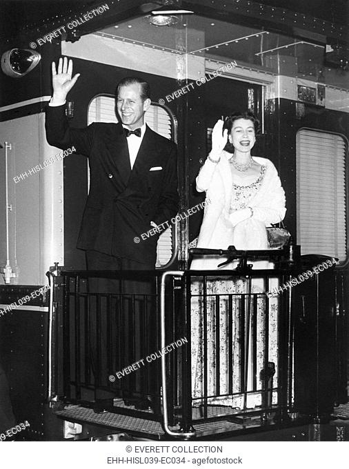 Queen Elizabeth II and Prince Philip wave from the back of a train at Union Station. After entertaining the President Eisenhower and the First Lady