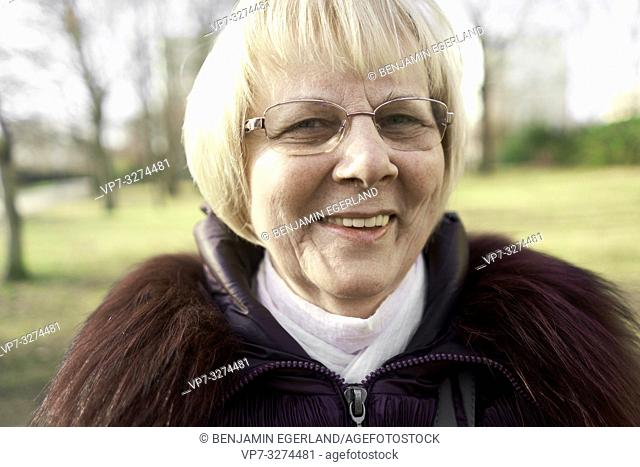 smiling senior woman outdoors in park, in Cottbus, Brandenburg, Germany