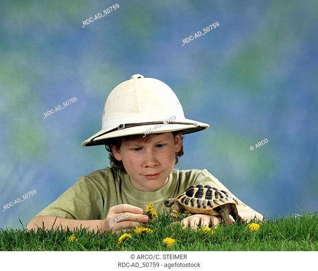 Boy with Greek Tortoise Testudo hermanni