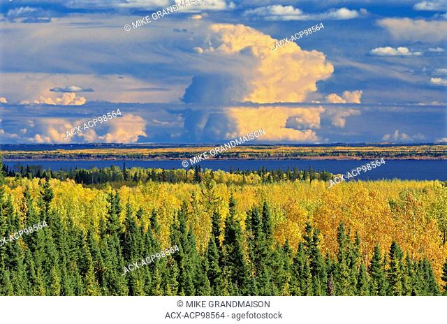 Storm clouds and boreal forest in autumn near La Ronge Saskatchewan Canada