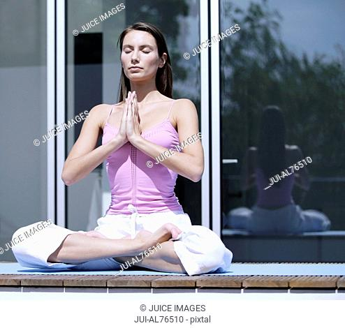 Portrait of a young woman meditating