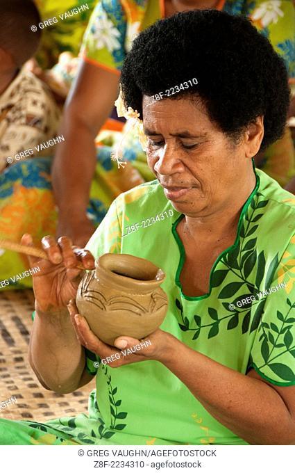 Woman making traditional pottery in Lawai village, Viti Levu Island, Fiji