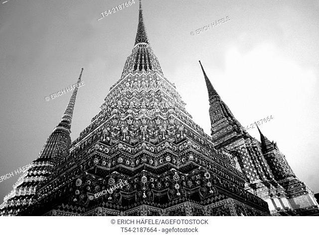 Illuminated Prang of Wat Pho in Bangkok