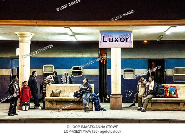 People waiting at the railway station at Luxor in Egypt at night