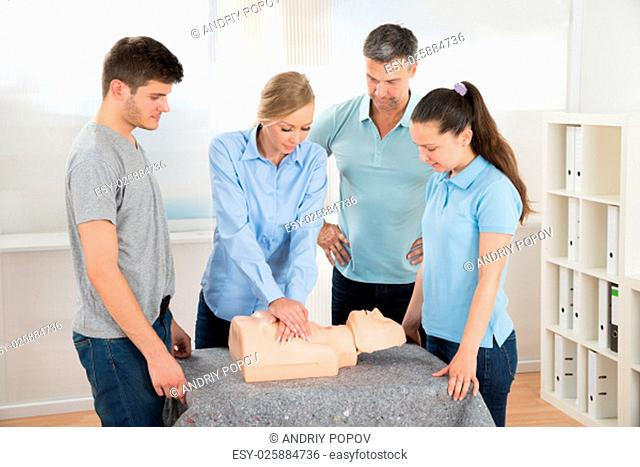 Group Of Students Learning Cardiopulmonary Resuscitation In Class