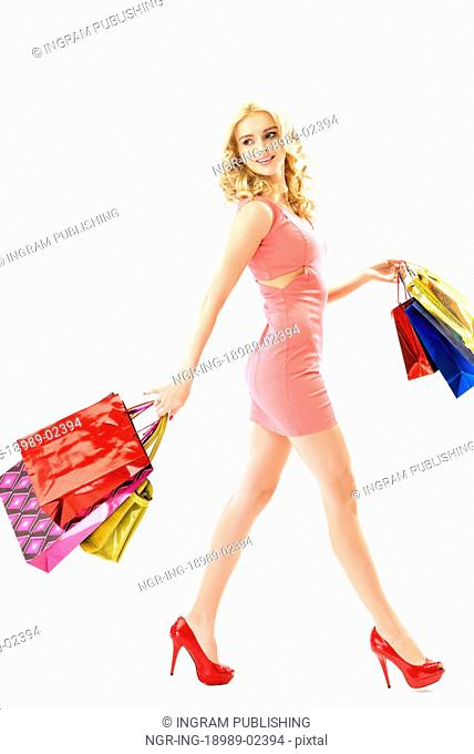 Blond cute woman on the Staurday shoping