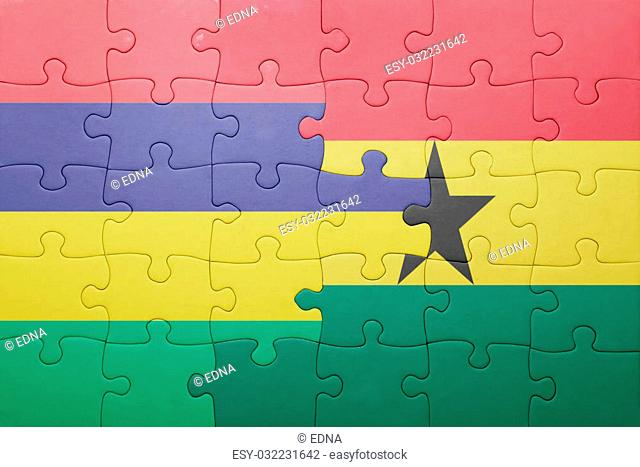 puzzle with the national flag of ghana and mauritius . concept