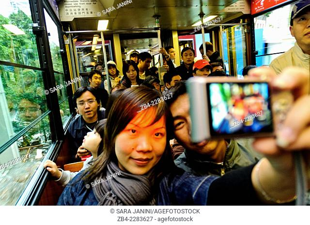 Tourists in the Peak Tramway (a funicular railway running from Central district to Victoria Peak), Hong Kong Island, Hong Kong, China, East Asia