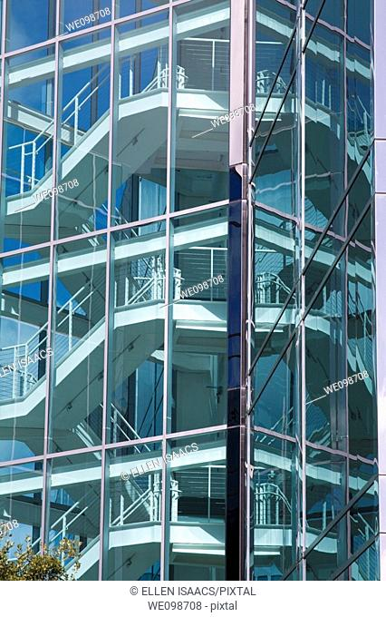 Staircase of sleek, modern office building in Silicon Valley as seen through glass walls. San Mateo, California, USA