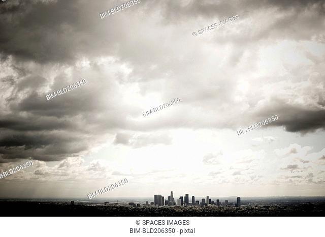 Los Angeles Skyline Beneath Cloudy Sky