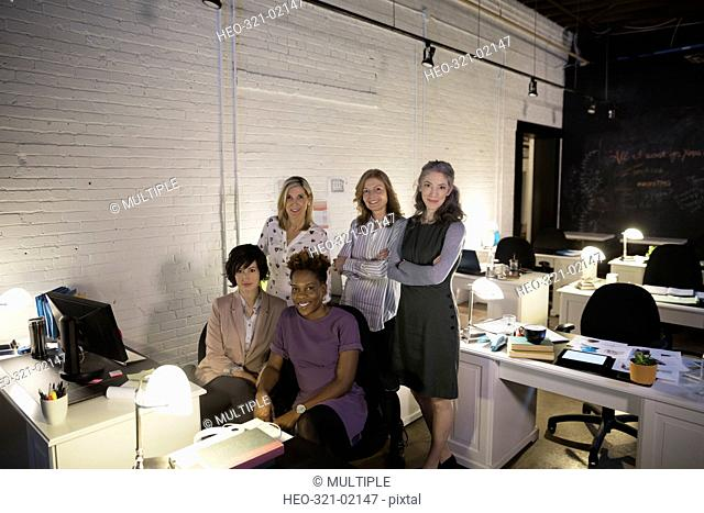 Portrait confident creative businesswomen in open plan office