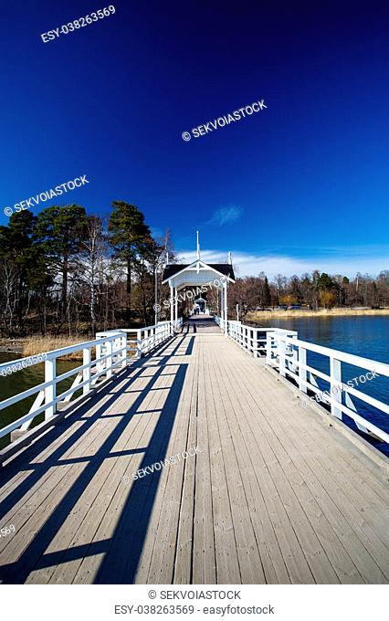 White wooden bridge with gates and deep blue sky