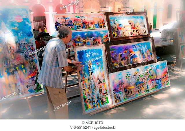 Artists selling work in shady area of artistic beautiful Prado area of Central Havana Cuba - 08/04/2015