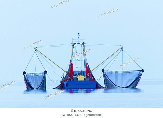 fishing trawler with tilted out fishing nets, Netherlands, Northern Netherlands, Den Burg