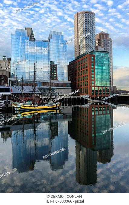 Waterfront buildings reflecting in water