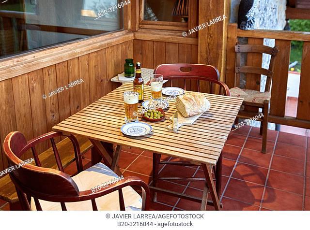 appetizer on the terrace, Urain Apartments, Basque farmhouse, Deba, Gipuzkoa, Basque Country, Spain, Europe