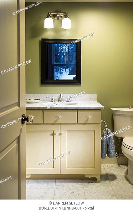 Traditional bathroom sink with marble countertop