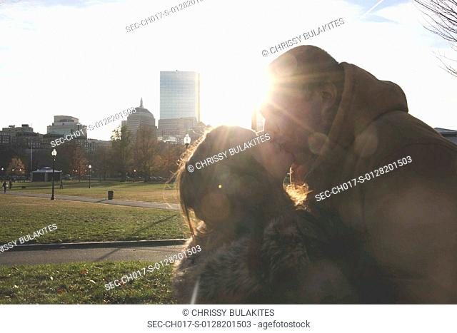 Young couple kissing in park