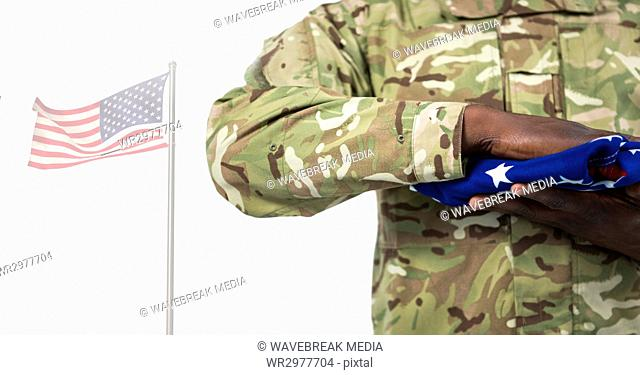 Soldier holding the american flag in front of white background