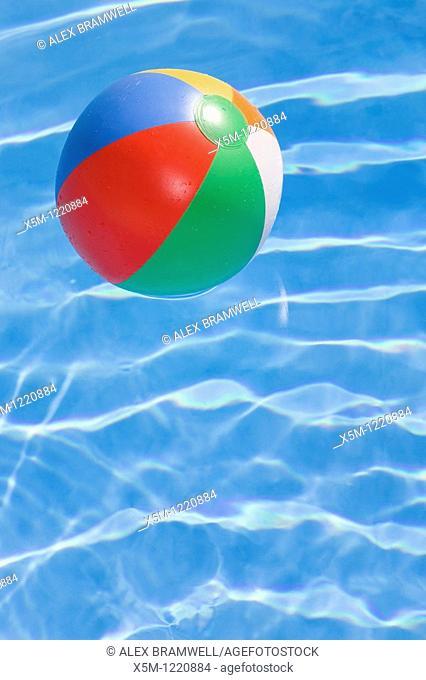Beachball in a bright blue pool