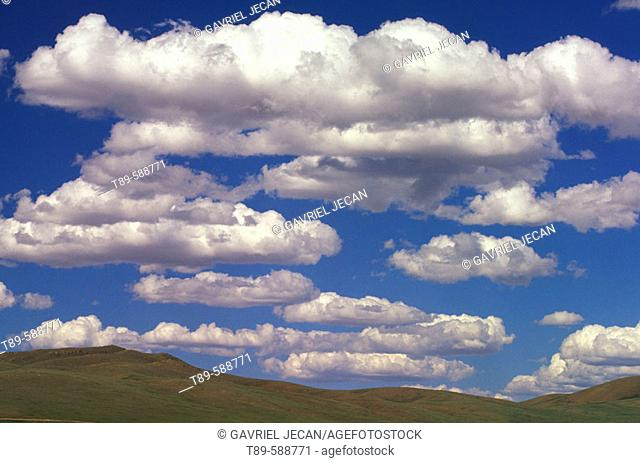 Clouds over the open grasslands of Mongolia. Gobi Gurvansaikhan National Park