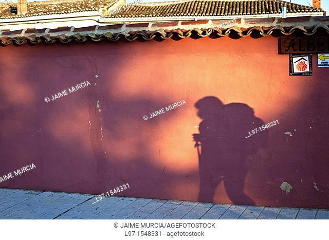 Shadow of a pilgrim on a wall along the Camino de Santiago