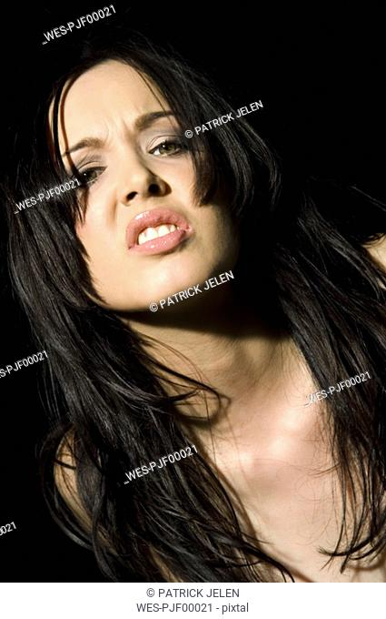 Dark-haired woman snarling