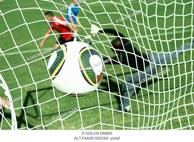 Soccer ball hitting goal net