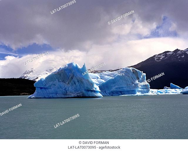 An iceberg is a large piece of ice that has broken off from a snow-formed glacier or ice shelf and is floating in open water