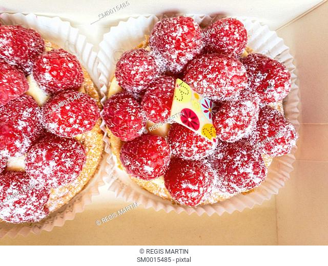 Two little gourmet raspberry tarts viewed from above
