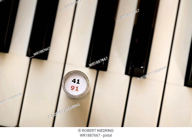 Piano keys and a weight, Regensburg, Bavaria, Germany