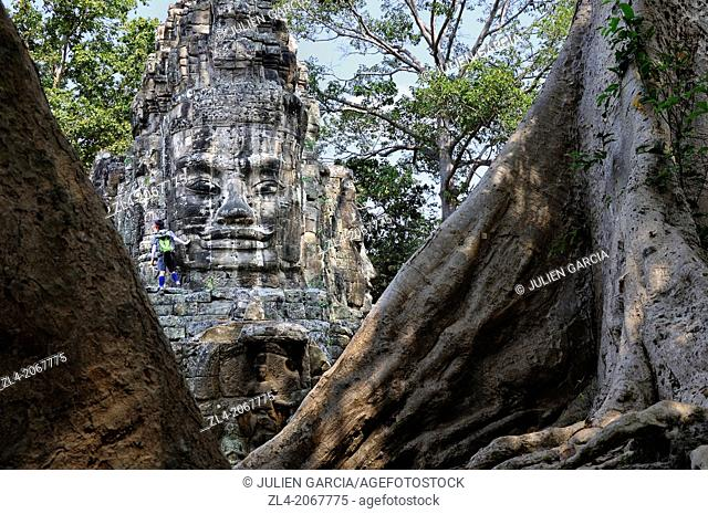 Enigmatic Lokesvara stone faces on the east gate of Angkor Thom. Cambodia, Siem Reap, Angkor